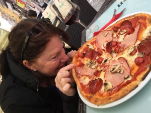 Cass tries to sneak a slice of the pizza we'd ordered for lunch, Brasov, Romania 2015