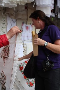 Buying up locally made craft at the stalls outside Castle Bran, Bran Romania 2015